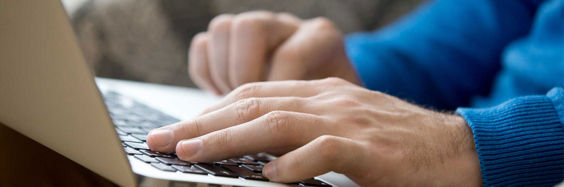 Male hands with laptop close-up